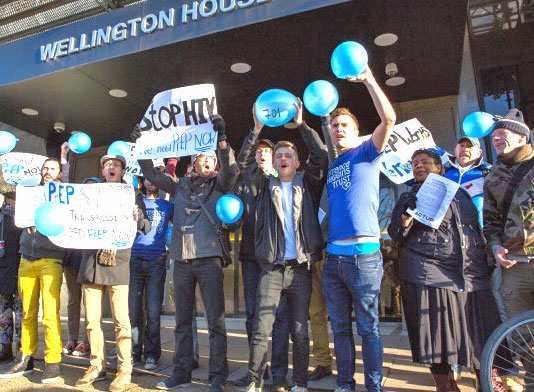 Photo of activists with blue baloons